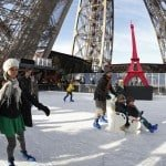 Tourists ice skate on the Eiffel Tower's skating rink in Paris